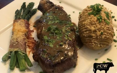 Wagyu New York Strip Steak au Poivre with Hasselback Potatoes & Prosciutto-wrapped Asparagus Bundles